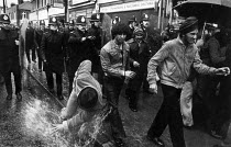 24-07-1979 - Black youth protest Blair Peach death, Southall, London 1979. Police pushing youth over. © John Sturrock