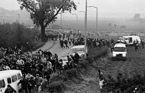 12-10-1984 - Police charging pickets, Miners Strike 1984 Brodsworth Colliery, Doncaster. Short shield unit attacking mass picket, Riot Police and mounted officers © John Sturrock