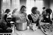 22-12-1984 - 1984 Miners Strike, women making Christmas dinner, Cadeby Miners Welfare, Yorkshire. Women laughing as they prepare food © John Sturrock