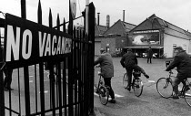 30-03-1983 - Workers going to work on their bikes, British Leyland Cowley, Oxford. No Vacancies sign. © John Sturrock