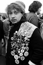 07-10-1984 - Striking Grimthorpe miner badge collection, 1984, Barnsley, Yorkshire. © John Sturrock