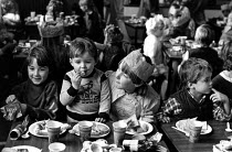 07-12-1984 - Children enjoying a Christmas party, Miners Strike 1984 Frickley colliery welfare with food donated from supporters, South Elmsall, Yorkshire. © John Sturrock