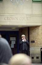 22-07-2010 - Barrister outside Luton Crown Court on his phone having a cigarette break. © Justin Tallis