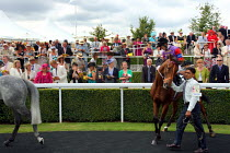 29-07-2010 - Horses are paraded around the winners enclosure at Goodwood racecourse. © Justin Tallis