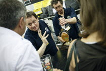 05-08-2010 - Having a chat with the bar man about the beer at The Great British Beer Festival, Earls Court, London. © Justin Tallis
