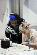 06-12-2010 - Students studying for a BA Hons in Fashion Textiles in a knitting workshop held in an open plan teaching area. Ravensbourne specialist higher education college, Greenwich, London. © Justin Tallis