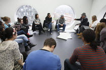 06-12-2010 - Students studying for a Foundation Diploma in Art and Design having a critique of their work. Held in an open plan teaching area they are showing of their designs to the class. Ravensbourne specialist... © Justin Tallis