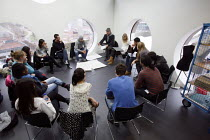06-12-2010 - Students studying for a Foundation Diploma in Art and Design in a tutorial- a critique of their work. Held in an open plan teaching area they are showing of their designs to the class. Ravensbourne sp... © Justin Tallis