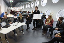 06-12-2010 - Students studying for a Foundation Diploma in Art and Design having a crit held in an open plan teaching area showing of their designs to the class. Ravensbourne specialist higher education college, G... © Justin Tallis