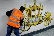 05-04-2011 - Offenders cleaning a mural of the Royal Carriage on the pedestrian tunnel walls of Hyde Park Corner tube (prior to the Royal wedding) as part of a community payback scheme run by Westminster Council a... © Justin Tallis