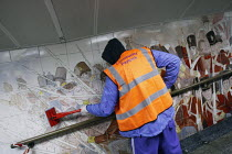 05-04-2011 - Offenders cleaning the pedestrian tunnel walls (and a mural of Battle of Waterloo) of Hyde Park Corner tube as part of a community payback scheme run by Westminster Council and the London Probation Tr... © Justin Tallis