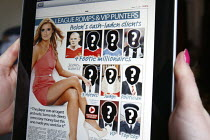 23-04-2011 - A kiss and tell story in the News of the World newspaper iPad digital online edition detailing the sexual activities of rich and wealthy people. The newspaper is unable to disclose the identities of t... © Justin Tallis