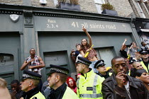 29-08-2011 - Police form a line along the edge of a crowd of revellers at Notting Hill Carnival. London. © Justin Tallis