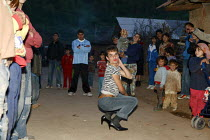 13-04-2007 - A Roma gypsy transvestite dancing in the street, in the town of Jibou, Romania. © Justin Tallis