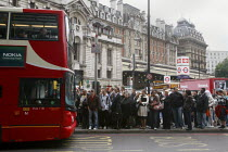 10-06-2009 - Crowds of commuters waiting for the bus outside London Victoria Station during the RMT tube strike. © Justin Tallis