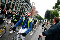 10-06-2009 - Cyclists take on the London rush hour traffic during an RMT tube strike. Central London. © Justin Tallis