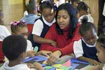 03-12-2008 - A teacher and pupils in a nursery class at Crary Elementary school, USA. © Jim West