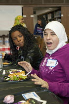 10-11-2009 - Dearborn, Michigan - Students from diverse backgrounds get to know each other at lunch hour on Mix It Up Day at Fordaon High School. Mix It Up Day is a national program which encourages students to as... © Jim West