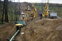 29-11-2011 - Workers building a natural gas pipeline in southwestern Pennsylvania where hydraulic facturing is commonly used to increase gas recovery. USA. laying the pipe in a trench. © Jim West