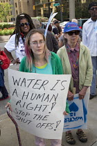 24-07-2014 - Detroit, Michigan - A delegation from Canada delivered water to Detroit as a protest against the city's water shutoffs. As it tries to recover from bankruptcy, the city is shutting off water to tens o... © Jim West