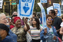 24-07-2014 - Detroit, Michigan - A delegation from Canada delivering water to Detroit as a protest against the city's water shutoffs. As it tries to recover from bankruptcy, the city is shutting off water to tens... © Jim West