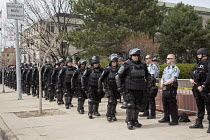 18-04-2015 - Toledo, Ohio - Armed Swat Police in riot gear protect members of the neo-Nazi National Socialist Movement (NSM) as they held a rally. Several hundred people turned out to protest against the Nazis. © Jim West