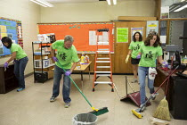04-08-2015 - Detroit, Michigan Volunteers from Life Remodeled, a nonprofit organization, clean and renovate classrooms at Osborn High School in an effort to improve the neighborhood. © Jim West