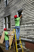 04-08-2015 - Detroit, Michigan Volunteers from Life Remodeled, a nonprofit organization, boarding up vacant houses in an effort to improve the neighborhood. © Jim West