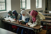 10-09-1990 - Young Muslim women studying at the main Gazi Husrev-beg mosque, Sarajevo, Bosnia. © Martin Mayer