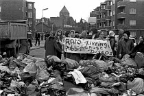 03-11-1970 - Council workers strike. Tenants protest at the rubbish mounting up outside their flats. © Martin Mayer