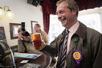 30-04-2013 - Farage surrounded by press has a pint of beer in a pub in the constituency. UKIP leader Nigel Farage campaigning during the 2013 South Shields by-election, Tyne and Wear, UK, 30/4 2013 © Mark Pinder