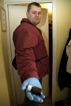 14-12-2005 - A drugs raid by police in East London. They forced their way into a flat and arrested one person for possession of class A drugs. The flat was searched with a sniffer dog. © Marco Secchi