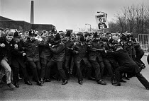 10-04-1984 - Striking miners mass picket, Agecroft colliery, Lancashire, 1984 workers pushing against police lines. Miners strike © NLA