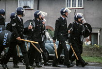06-10-1984 - Police with batons at the ready, Armthorpe pit village 1984 searching for striking miners, Yorkshire © NLA