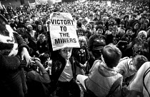 10-05-1984 - Womens support groups Rally, Barnsley 1984 in support of the miners strike. A boy holds up Victory To the Miners placard © Peter Arkell