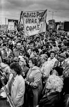 07-05-1984 - Striking miners protest, Mansfield, 1984 Nottinghamshire, their families, and supporters. Banner: Grass Pie Here We Come! © Peter Arkell