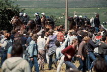 30-05-1984 - Striking miners confront mounted police at Orgreave coking plant, near Sheffield, South Yorkshire. © Peter Arkell