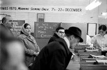 22-12-1970 - Brixton Employment Exchange. Signing on just before Christmas. London © Peter Arkell