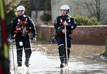 07-02-2014 - Police walk the streets of Moorland checking on residents, on the Somerset levels. © Paul Box