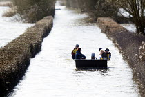 04-02-2014 - Residents get a humanitarian boat to their homes in Moorland, Somerset after the river Parrett breaks its banks. © Paul Box