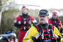 04-02-2014 - Police escort residents via boat to their homes in Moorland, Somerset after the river Parrett breaks its banks. © Paul Box