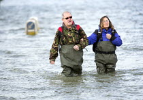 13-02-2014 - Residents of Windsor, Berkshire which has been flooded after the Thames burst its banks wade through flood waters. © Paul Box