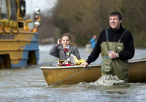 13-02-2014 - The school run: A father ferries his daughter to school in a canoe. Windsor, Berkshire which has been flooded after the Thames burst its banks wade through flood waters. © Paul Box