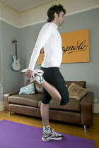 07-03-2006 - A man doing stretches, in preparation for cycling. © Paul Box