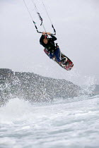 16-10-2006 - A kitesurfer performing jumps, at Parr Sands in Cornwall. © Paul Box