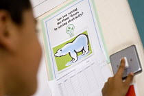 29-04-2009 - Turning off lights checklist as part of the Eco-Schools Award, at Hillcrest Primary School in Bristol. © Paul Box
