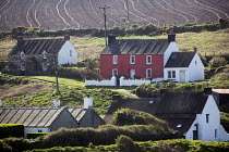 14-04-2009 - Old cottages with newly ploughed fields in the background, in Abereiddy, Pembrokeshire. © Paul Box