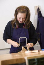 03-12-2008 - Using a hacksaw in woodwork, Bristol City Academy, Bristol. © Paul Box