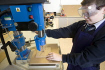 03-12-2008 - Using a pedestal drill in woodwork, Bristol City Academy, Bristol. © Paul Box