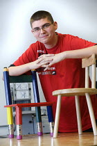 03-12-2008 - Pupil with chairs he has made. Bristol City Academy, Bristol. © Paul Box